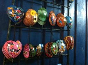 Coconut shells painted in the Tingatinga style by AfricMAK.