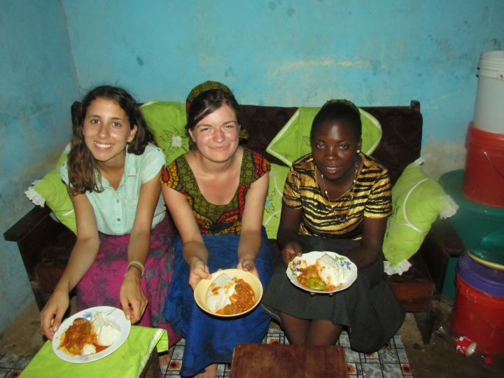 Emanuela (the other Farm Radio intern in Tanzania), me and Veronica with our ugali wa nasi na mboga mboga